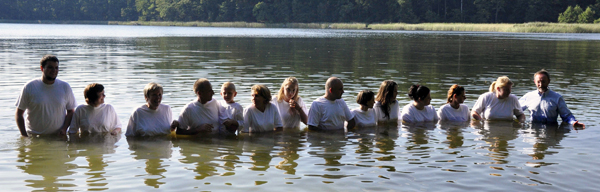 Thirteen Come to Christ and are Baptised