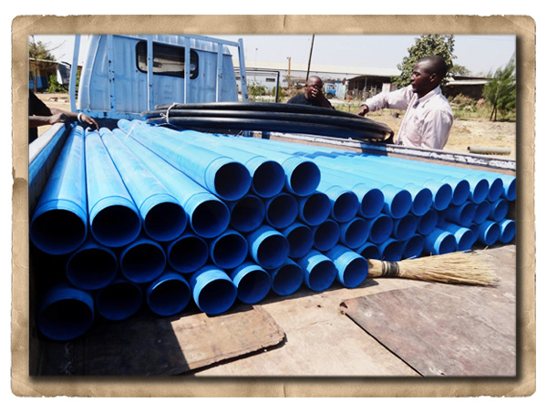 Blue pipes in a truck bed