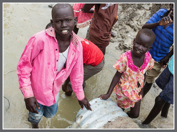 Refugee Children standing in water