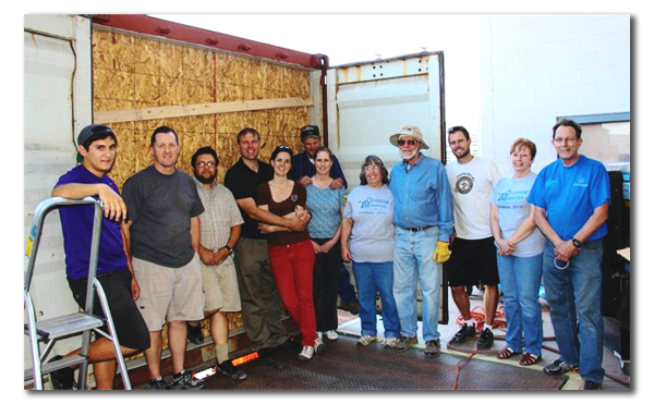 Volunteers came from all over to help load the container.