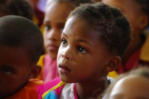 A girl listens with interest to the gospel being presented at Keimoes